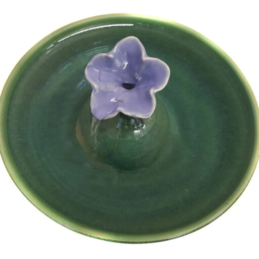 A gorgeous cat fountain in a Petunia design with a Lavender Blue blossom and a Deep Spruce fountain bowl. Water fills the blossom and streams into the bowl. Excellent for long hair cats. * 3.25 inches high by 12